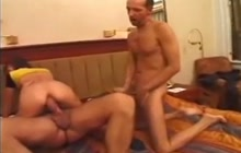 German chick takes 2 huge cocks